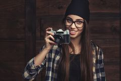 Smiling girl in glasses with vintage camera Royalty Free Stock Photography
