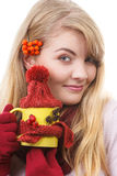 Smiling girl in gloves holding cup of tea with woolen scarf and cap Stock Image