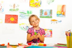 Smiling girl with glue stick Royalty Free Stock Photography