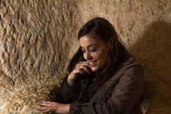 Smiling girl going out of a hole inside a cave Stock Photos