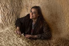 Smiling girl going out of a hole inside a cave Royalty Free Stock Photos
