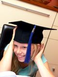 Smiling girl in graduation cap stock photo