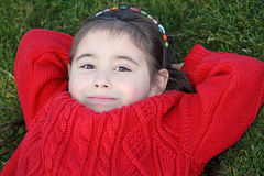 Smiling girl on grass Stock Images