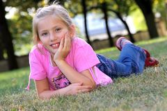 Smiling girl on the grass. Royalty Free Stock Photo