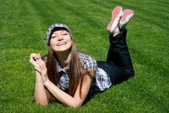 Smiling girl on the grass Stock Photography