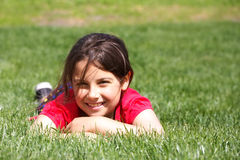 Smiling girl in grass Stock Photos