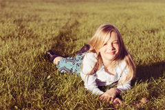 Smiling girl in grass Royalty Free Stock Images
