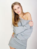Smiling girl in a gray home jacket Royalty Free Stock Photo