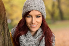 Smiling girl with a gray scarf and cap Royalty Free Stock Image
