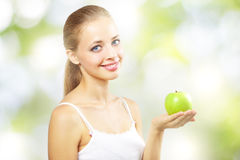 Smiling girl with green apple Royalty Free Stock Image