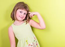 Smiling girl  on green background Royalty Free Stock Photo