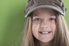 Smiling girl in green cap Royalty Free Stock Photo