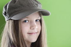 Smiling girl in green cap Stock Photography