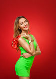 Smiling girl in a green dress in the style of pin-up, isolated o Royalty Free Stock Image
