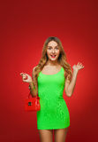 Smiling girl in a green dress in the style of pin-up, isolated o Royalty Free Stock Photos