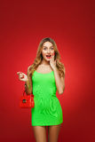 Smiling girl in a green dress in the style of pin-up, isolated o Stock Photography