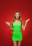 Smiling girl in a green dress in the style of pin-up, isolated o Stock Photos