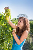 Smiling girl with green grapes Stock Image
