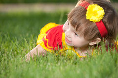Smiling girl on the green lawn Royalty Free Stock Images