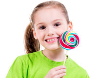 Smiling girl in green t-shirt with colored candy. Stock Photography