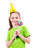 Smiling girl in green t-shirt with colored candy. Royalty Free Stock Images
