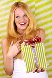 Smiling girl with green white gift Royalty Free Stock Photo