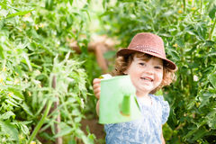 Smiling girl in the greenhouse Royalty Free Stock Image