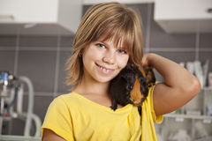 Smiling girl with guinea pig Stock Photos