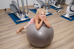 Smiling girl in the gym Stock Images