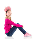 Smiling girl with hair bow. Stock Images