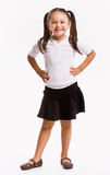 Smiling girl with hands on hips Royalty Free Stock Photos