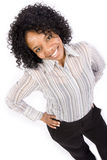 Smiling girl with hands on hips Stock Photography