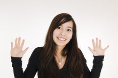 Smiling girl hands up Stock Images