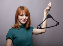 Smiling girl with hanger Royalty Free Stock Images