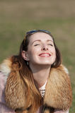 Smiling girl. Girl happily smiling sun first Royalty Free Stock Photo