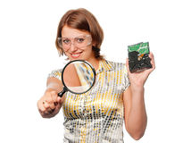 Smiling girl with  hard driver and  magnifier Stock Photography