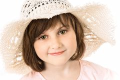 Smiling girl in a hat stock image