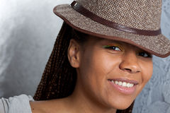 Smiling girl in a hat royalty free stock photos