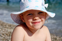 Smiling girl in hat Royalty Free Stock Photos