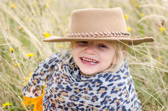 Smiling girl with hat in autumn grass Stock Photos