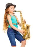 Smiling girl with hat playing alto saxophone Royalty Free Stock Photography