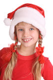 Smiling girl in hat of santa claus. Isolated Royalty Free Stock Photo