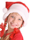 Smiling girl in hat of santa claus. Isolated Royalty Free Stock Image