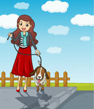 A smiling girl having a dog Royalty Free Stock Image