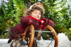 Smiling girl having fun in winter snow on a sledge Stock Photography