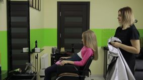 Smiling girl having her hair done by hairstylist stock footage