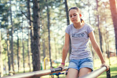 Smiling girl having sport activities outdoors. Beautiful smiling girl having sport activities outdoors Royalty Free Stock Images
