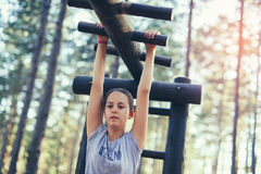 Smiling girl having sport activities outdoors. Beautiful smiling girl having sport activities outdoors Stock Images