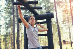 Smiling girl having sport activities outdoors. Beautiful smiling girl having sport activities outdoors Royalty Free Stock Photo