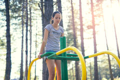 Smiling girl having sport activities outdoors. Beautiful smiling girl having sport activities outdoors Royalty Free Stock Image